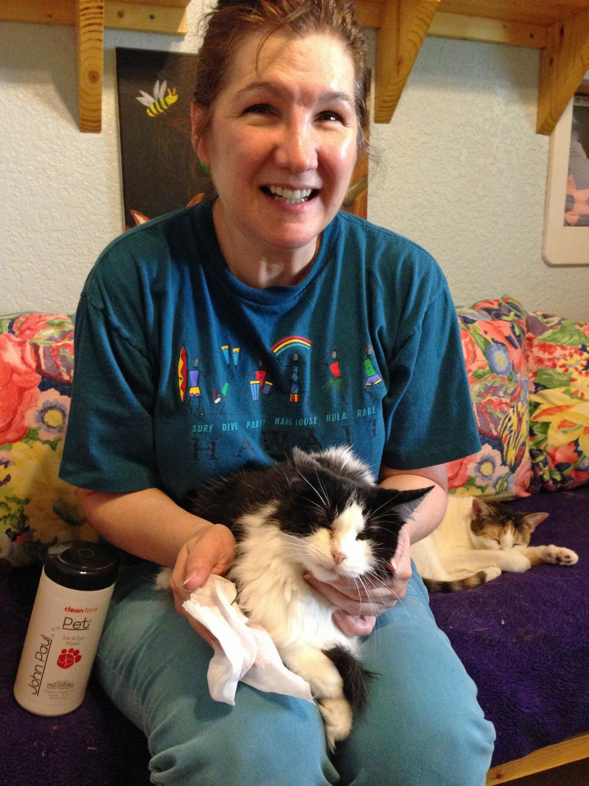 Volunteer Susan VandeVoorde gives Polly an eye bath.